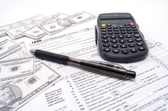 Tax Form Cash and Calculator Stock Images