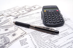 A Tax Form Cash and Calculator Stock Image