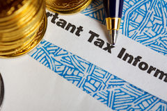 Tax form with coins Stock Images