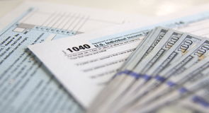 Tax Form 1040 with 100 dollars Stock Images