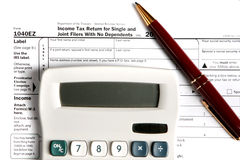 Tax form EZ with calculator and pen Stock Photo