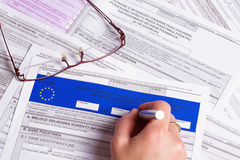 Tax form. Hands of business woman filling tax form Stock Images