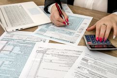 Tax form 1040 human hands stock images