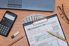 1040 Tax form with laptop on table Stock Photos