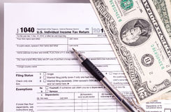 Tax form and Money Stock Images