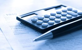 Tax form, pen and calculator Stock Image