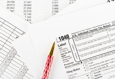 Tax form 1040  for US individual tax return with pen Royalty Free Stock Photos