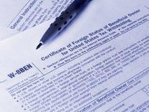 Tax form W-8BEN Royalty Free Stock Photos