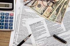 Tax form w4 with dollar, pen Royalty Free Stock Photography