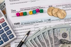 Tax form with wooden cubes, dollar. Bills, coin Royalty Free Stock Images