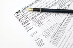 Tax forms. Filling out income tax forms Royalty Free Stock Photography