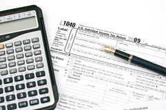 Tax forms. Filling out income tax forms Stock Image