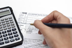 Tax forms. Filling out income tax forms Stock Photos