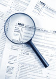 Tax forms. United States 1040 tax forms and a jar of coins stock photography