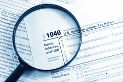 Tax forms. Investigation concept with magnifying glass and 1040 US Income Tax Return Stock Image