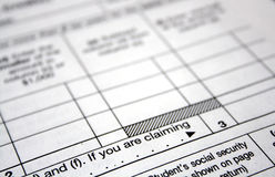 Tax forms. Close-up of a white tax form ready to be filled out stock photography