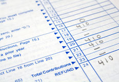 Tax forms. Close-up of a white tax form partially filled out stock photography