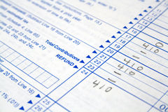 Tax forms. Close-up of a white tax form partially filled out royalty free stock photo