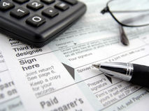 Tax forms. Multiple tax forms with pen, calculator and glasses royalty free stock photos