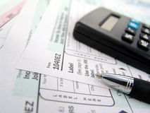 Tax forms. Multiple tax forms with pen and calculator royalty free stock photography