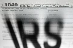 Tax forms background with IRS. Shadow Stock Images