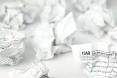 Tax forms balled and thrown away. In frustration Royalty Free Stock Photos
