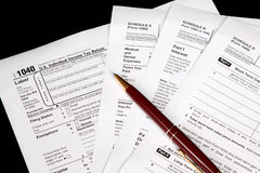 Tax forms on black background Royalty Free Stock Photography