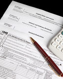 Tax forms with calculator and pen Stock Image