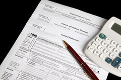 Tax forms with calculator and pen Stock Photo