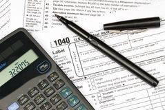 Tax forms, calculator and pen Stock Image