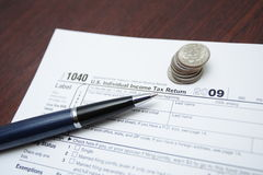 Tax forms, coins and pen Royalty Free Stock Photos