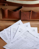 Tax forms in a leather briefcase Royalty Free Stock Photography