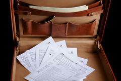 Tax forms in a leather briefcase Royalty Free Stock Image