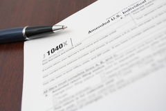 Tax forms and pen on a desk Royalty Free Stock Photography