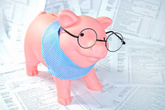 Tax forms with piggy bank Stock Photos