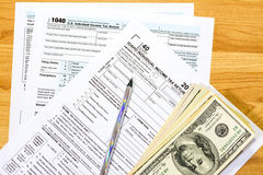 Tax forms for the state of Idaho and money Royalty Free Stock Photos