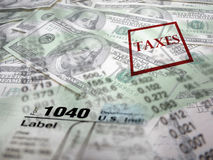 Tax Forms on top of Money. Detail closeup of current tax forms and pencil on money Royalty Free Stock Image