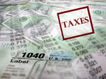 Tax Forms on top of Money Royalty Free Stock Image