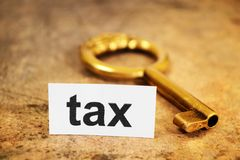 Tax and  golden key Stock Image