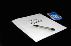 Tax Guide Document with Pen and Calculator Stock Photo
