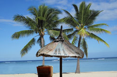 Tax Haven. Stand, sun, sea, palm beach chair. So one imagines a tax haven stock photography