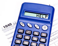 Tax help. 1040 Tax Return Form a calculator with the text help royalty free stock image