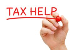 Tax Help Red Marker. Hand writing Tax Help with red marker on transparent wipe board royalty free stock images