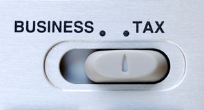 Tax is an important factor in a business. Tax is an important decision factor in a business Royalty Free Stock Photos