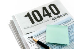 Tax instructions, form and sticker. Stock Photo