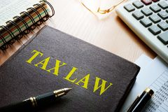 Tax law on a table. Taxation concept stock photos