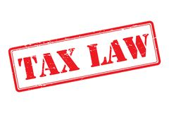 "Tax law. Text ""tax law"" in bold grunge uppercase letters inside a rectangle outlined in red, white background, concept of rubber stamp Stock Photos"