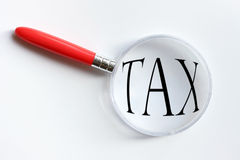 Tax Magnification. Magnifying Glass over the word tax stock image