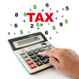 Tax. Male hand typing on calculator. Tax concept Royalty Free Stock Photography