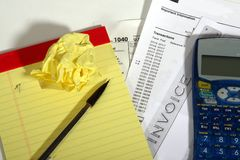 Tax mistake. Calculator, pad, pencil, and tax forms Royalty Free Stock Photos